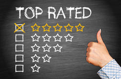 Top Rated - five stars with thumb up stock photography