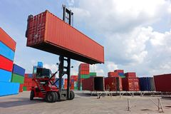 Top reach stacker is handling 40` high cube empty to put on repait bar yard in container depot stock images