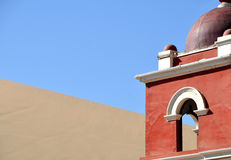 Top of a red church tower in desert Stock Images
