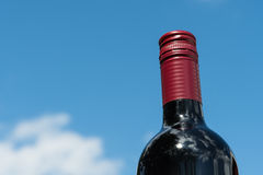 Top of a red wine bottle. By a blue summer sky Stock Photo