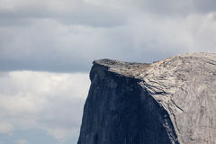 Top ridge of Half Dome mountain viewed up close in Yosemite National Park Stock Photo