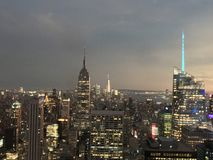 From the Top of the Rock. View of Midtown and Downtown Manhattan as night and some rain fall stock images