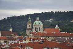 Top of the roof of St Nicholas Church from Prague in Czech Republic Stock Photos
