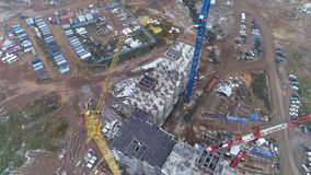 A rotating view of a large construction site and its facilities. A top rotating view on a construction site with the main building and trailers stock video footage