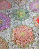 Antique Grandmother`s Garden Quilt royalty free stock image