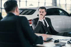 Top sales manager and customer at dealership showroom stock photo