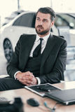 Top sales manager at dealership showroom.  Royalty Free Stock Images