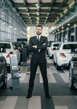 Top sales manager at dealership showroom.  Royalty Free Stock Image