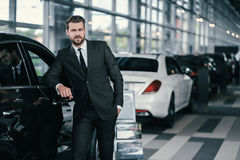 Top sales manager at dealership showroom.  Stock Photography