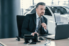 Top sales manager at dealership showroom.  Royalty Free Stock Photography
