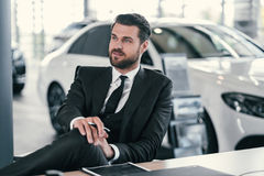 Top sales manager at dealership showroom Stock Photos