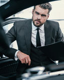 Top sales manager at dealership showroom.  Stock Photos