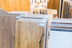 Top samples of various color palette for wooden floor. In the building store royalty free stock image