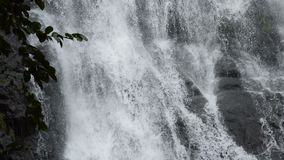 Top of Sarika big waterfall in Thailand tilt down and panning to foothills. On river stock footage