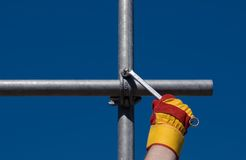 Top of the scaffold. Connecting scaffold bars - against blue sky Royalty Free Stock Images