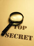 Top secret. Magnifying glass on the text of secret stock images