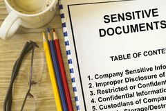 Sensitive  classified information concept. Top secret classified information concept- with contents of lecture on a cover sheet Stock Photo