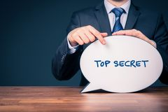 Top secret concept. Businessman with speech bubble representing communication royalty free stock image