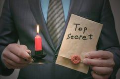 Top secret message concept. Super important information. Confidential dossier. Top secret concept. Top secret documents or message in businessman hands royalty free stock images