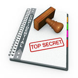 Top secret concept. Notebook and rubber stamp with the words top secret Royalty Free Stock Image