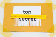 Top Secret, destroying sheet of paper with yellow zipper as a sh Royalty Free Stock Images