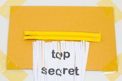 Top Secret, destroying sheet of paper with yellow zipper as a sh Stock Photo