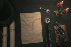 Crumpled paper page sheet with copy space on detective agent desk table and key to unraveling. THe clue. Top secret document information. Privacy. Forbidden Stock Photo
