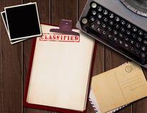 Top secret document. Vintage desk with top secret documents and photographs Stock Photo
