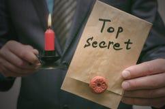Top secret documents concept. Super important information. Confidential message. Top secret concept. Top secret documents or message in businessman hands royalty free stock image