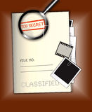 Top Secret File. An image showing a file named top secret and classified with file number written on it. It also shows a magnifying glass, Polaroid and 35mm film Stock Images