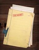 Top secret file. Top secret file on wooden table Stock Photos