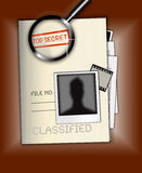 Top Secret File Photo. An image showing a file named top secret and classified with file number written on it. It also shows a magnifying glass, Polaroid and Stock Images