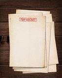Top secret files. Top secret files on wooden table Royalty Free Stock Photography