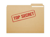 Top Secret Folder. Top secret brown folder file with paper showing with a lot of copy space. Isolated on a white background with clipping path Royalty Free Stock Image