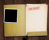 Top secret folder. Folder with TOP SECRET stamped across the front page and a blank photograph Stock Photography