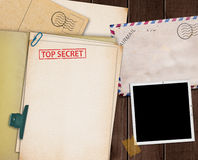 Top secret folder. Folder with TOP SECRET stamped across the front page and a blank photograph Stock Images