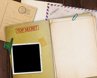 Top secret folder. Folder with TOP SECRET stamped across the front page and a blank photograph Stock Photo