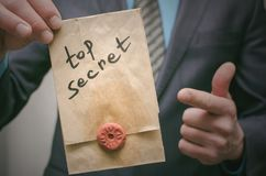 Top secret message concept. Super important information. Confidential dossier. Top secret concept. Top secret documents or message in businessman hands royalty free stock photography