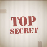 Top secret. Text on cardboard texture Royalty Free Stock Photography