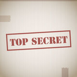 Top secret. Text on cardboard texture Stock Images