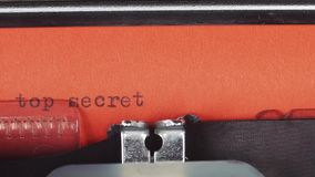 Top secret - Typed on a old vintage typewriter. Printed on red paper. The red paper is inserted into the typewriter.  stock video footage