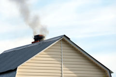 Top section of country house with smoke pipe Royalty Free Stock Photography