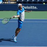 Top seeded junior player Axel Geller of Argentina in action during US Open 2017 junior boys` singles semifinal match. NEW YORK - SEPTEMBER 9, 2017: Top seeded Stock Photo