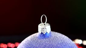 Top of shiny blue toy for Christmas or New Year. Top of shiny blue toy for Christmas tree for decoration Christmas or New Year and red and white beads, rotation stock video