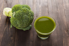 Top shot broccoli juice on wood table. Royalty Free Stock Image