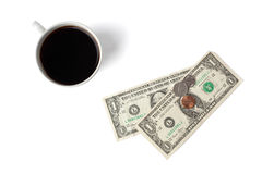 Top shot of coffee cup with money Royalty Free Stock Photos