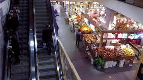 Top shot of customer buying foods and taking escalator stock footage