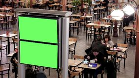 Top shot of food court with green screen for your ad. At YVR airport stock video