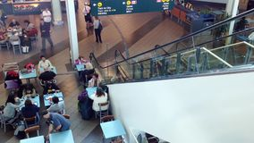 Top shot of food court at YVR airport. Top shot of food court with escalator on side at YVR airport stock footage