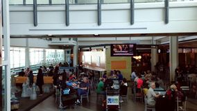 Top shot of food court at YVR airport. Top shot of food court with escalator on side at YVR airport stock video footage
